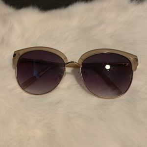 Sunglasses with tan detail on the top